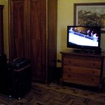 here you see the TV,, closet and the brown decor