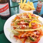 Freshly made jerk tacos at the hotel restaurant. Cold beer and hot sauce. Really good flavor.