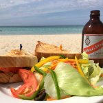A lovely grilled jerksandwich with local fresh veggies. A supersandwich on the beach with a cold