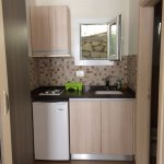 Kitchenette with stove top, frig and fresh drinking water