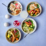 Marketbowls full of fresh seasonal sides and proteins