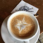 Latte with a starfish, at the bar while waiting for breakfast
