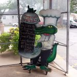 the welcome gator with specials at the front door