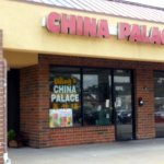 front of & entrance to Wing's China Palace