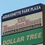 large plaza sign along 115th St. for 115 Bourbon Street