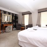 This is one of our larger double bedrooms with a view over the main street