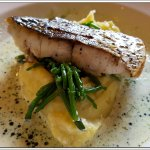 The fillet of Stone Bass with Crushed potatoes and a buttery chive oil sauce