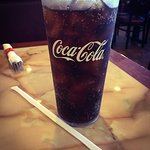 Charlie's Mongolian BBQ proudly serves free drink refill Coca Cola products.