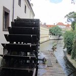 A view of the waterwheel and canal you see on the boat ride