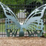 A bench shaped like a butterfly.