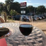 my wine on table overlooking parking lot outside the restaurant