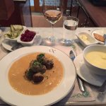 Köttbullar (Swedish meatballs in cream sauce with potato purée, lingonberries and pickled cucumb