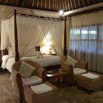 Traditional, mossie net, thatch roof, marble floor
