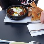 Wagu meatballs with baked eggs and focaccia toast