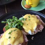 My brunch, egg benedict with ham and long black coffee.
