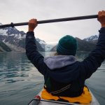 Paddling on tranquil waters with Northwestern Glacier in the background