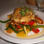 filet of corvina with red and green peppers, pineapple sauce and chunks