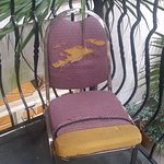 One of the two chairs on our balcony.