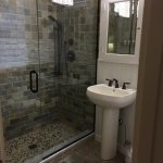 Roomy tiled shower with waterfall shower head