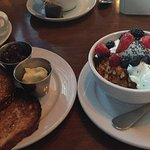 Granola with fresh berries , yogurt and whole grain toast