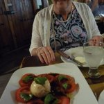 a beautiful caprese. note 1 of owner's daughters in background