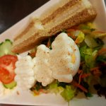 Egg mayo starter served with salad, coleslaw and mixed bread