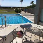 Swim up room, two sunloungers and two seats one table. Room 7001