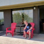 My son enjoying our patio out the door from our room.