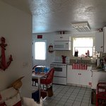 fully equipped kitchen with full size refrigerator
