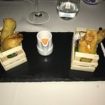 Starter of Tempura fried Zucchini flower stuffed with mozzarella and anchovy