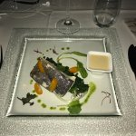 Grilled sea bass on a bed of seasonal vegetables