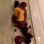 Caramel ice-cream bar with honeycomb, chocolate soil and berry sauce