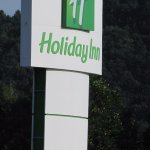 Holiday Inn sign at main entrance of hotel.