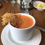 Gouda Tomato Bisque with melted cheese wafer