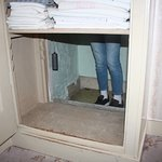 The cupboard access to the hiding place
