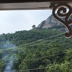 "From front porch of Medina's: see the ""chimney"" on the left edge of Chimney Rock Mountain, N. C."