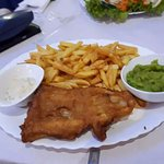 Cod in a light, crispy batter, served with chips and mushy peas - delicious!