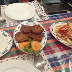 spicy mango salad and fish cakes