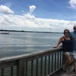 My wife and I waiting for the Lake Dora Sun Set on the dock in front of the Historic Lake Side I