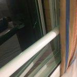 Window ajar and broken glass