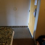 barely enough space between bed and door to open the door