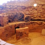 A kiva with crumbled walls.