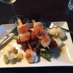 Scallops with bacon jam and risotto cakes