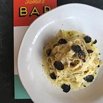 Tagliatelle pasta tossed in a indulgent truffle cream sauce, parmesan cheese & fresh truffles