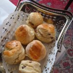 6 mini warm scones some plain some with fruit served with clotted cream and jam