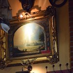 Every wall is covered with paintings, the interior is like an overstuffed antique shop, wonderfu