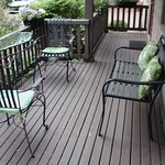 Comfortable chairs to sit in and relax on the porch.
