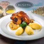 Pork knuckle in fried sauerkraut with horseradish puree