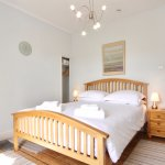 Coverdale bedroom with king size bed and en suite shower room