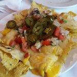 Degustaciòn de tacos, aperitivo con totopos y nachos como entrante, todo bañado con un margarita